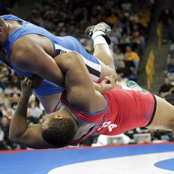 Jarod Trice, bottom, of Highland Park, Mich., throws Dom Bradley, top, of Blue Springs, Mo., off the mat during their 120kg freestyle match at the U.S. Olympic Wrestling Team Trials, Sunday, April 22, 2012, in Iowa City, Iowa.