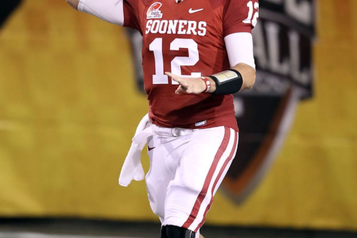 Landry Jones returns to Oklahoma for a senior season but must develop a strong rapport with young receivers and tight ends this spring. (Photo by Christian Petersen/Getty Images)