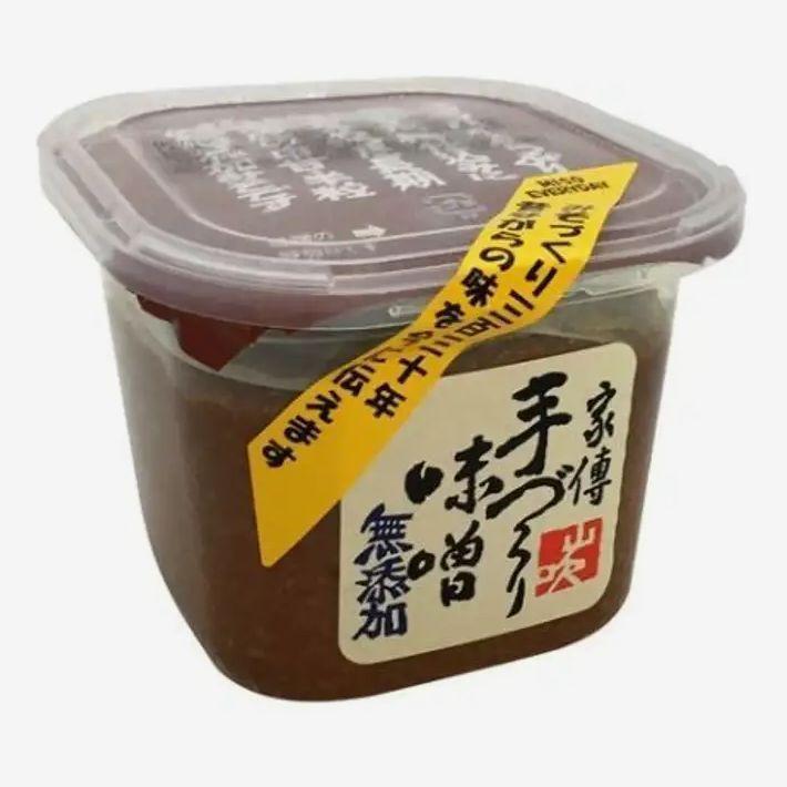 a container of Yamabuki Mutenka Shiro Miso