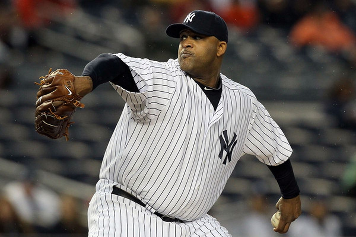 NEW YORK - APRIL 16:  CC Sabathia #52 of the New York Yankees delivers a pitch against the Texas Rangers on April 16, 2010 at Yankee Stadium in the Bronx borough of New York City.  (Photo by Jim McIsaac/Getty Images)