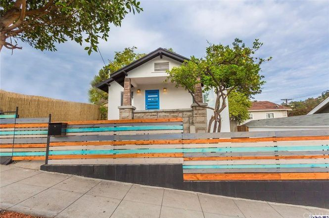 Front of house with colorful fence