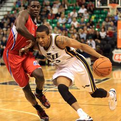 The Utah Jazz's Trey Burke runs around L.A. Clippers' Darren Collison during a basketball game at the EnergySolutions Arena in Salt Lake City on Saturday, Oct. 12, 2013.
