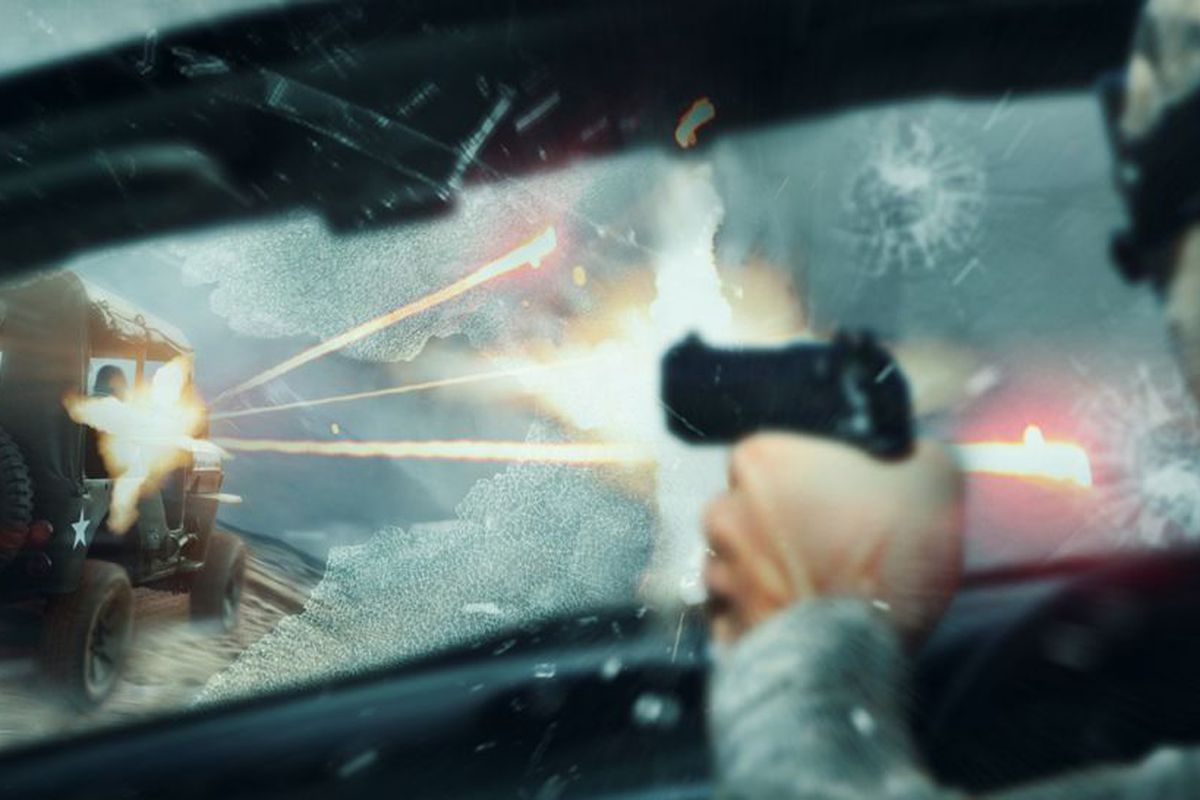 A player fires through the windshield of a speeding car with a 1911-type pistol at an opposing player speeding away in a jeep.