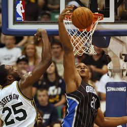 Orlando Magic's Danile Orton, right, grabs a rebound from Utah Jazz's Al Jefferson during the first half of an NBA basketball game in Salt Lake City, Saturday, April 21, 2012.
