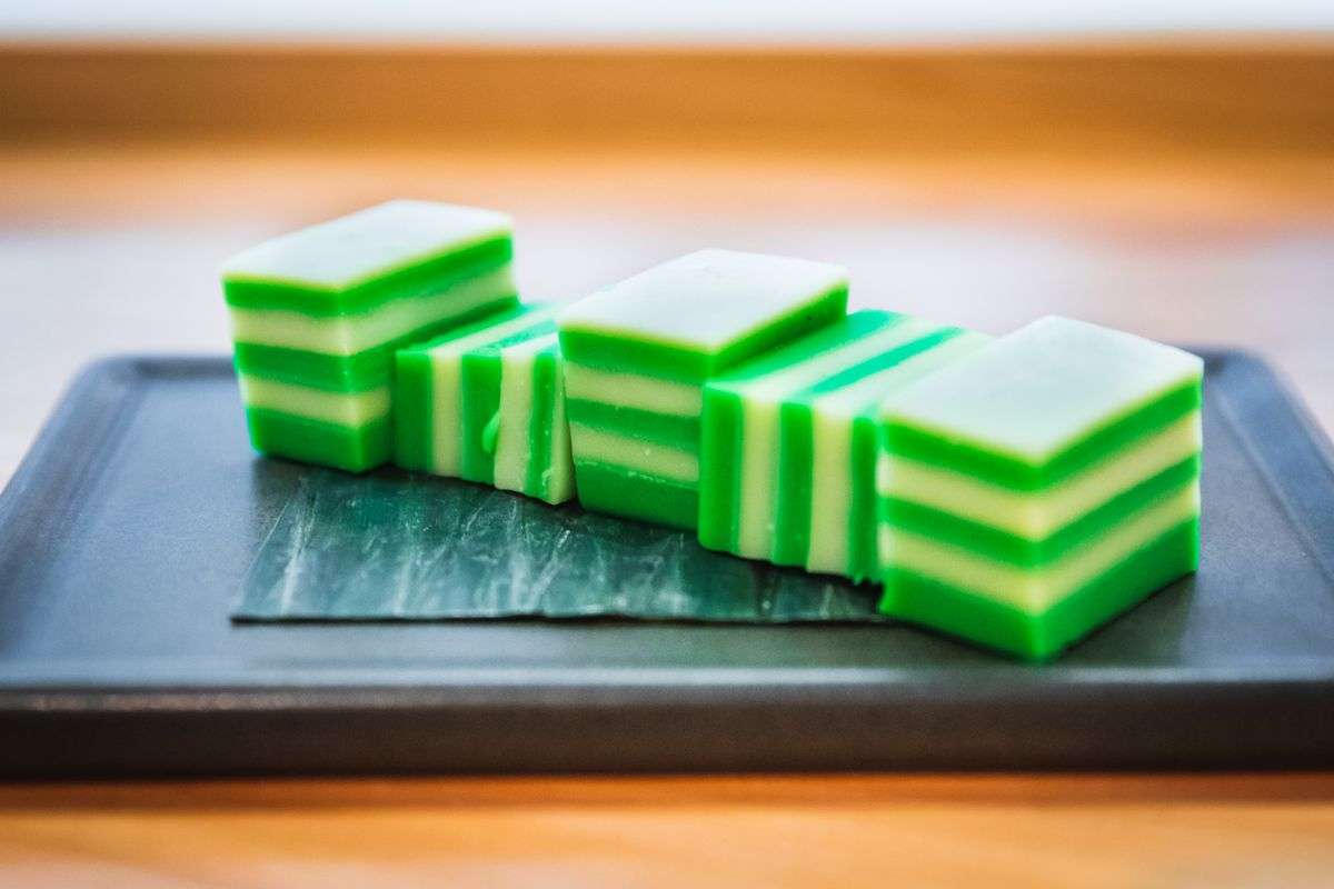 Small squares of green and white layered cake