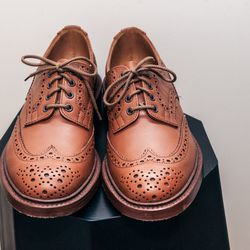 """<b>Tricker's</b> brogue, <a href=""""http://store.inventorymagazine.com/collections/footwear/products/trickers-keswick-brogue-c-shade"""">$525</a>"""