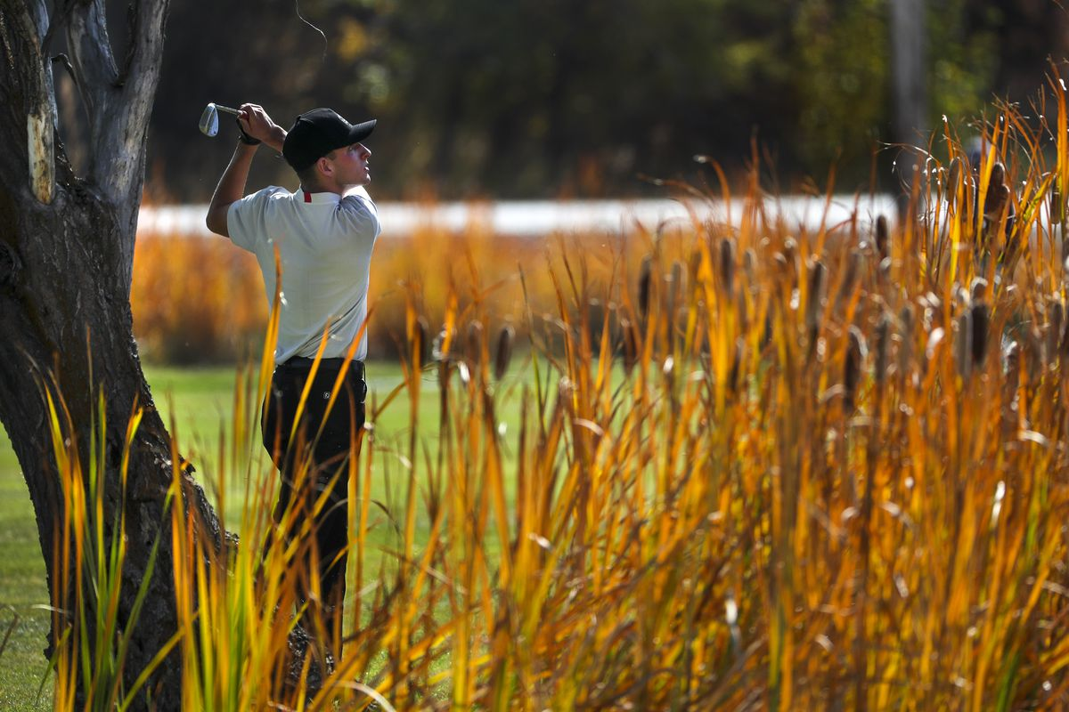 Judge Memorial golfer Nico Smith hits his approach shot over a pond during the 3A boys state golf championship at Round Valley Golf Course in Morgan on Thursday, Oct. 8, 2020. Smith finished in a tie for fourth place.