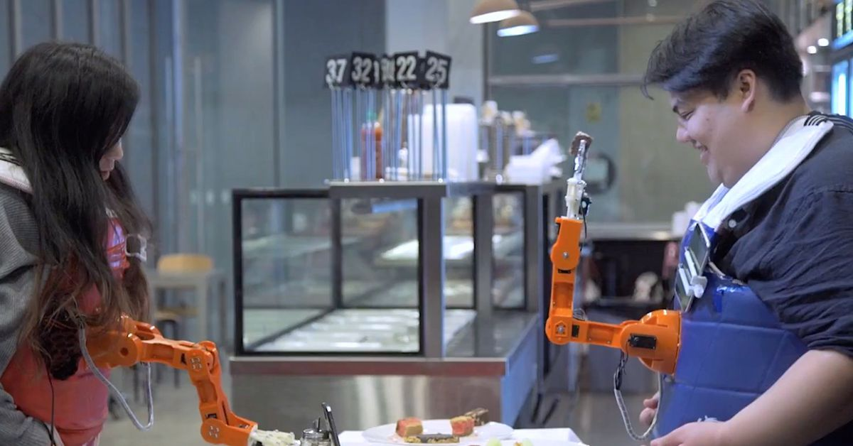 This Chest-mounted Robot Feeding Arm Could Stuff your Face When You're Too Full to Move