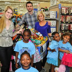 Orlando Magic guard J.J. Redick and his wife Chelsea took youth from the Boys and Girls Club shopping as part of the Magic and Pepsi holiday shopping spree on December 18