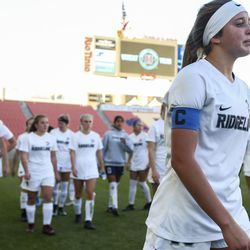 Ridgeline forward London Miller walks back to the Ridgeline bench with her team after falling in the 4A girls state championship 2-1 to Ogden at Rio Tinto Stadium in Sandy on Friday, Oct. 25, 2019.