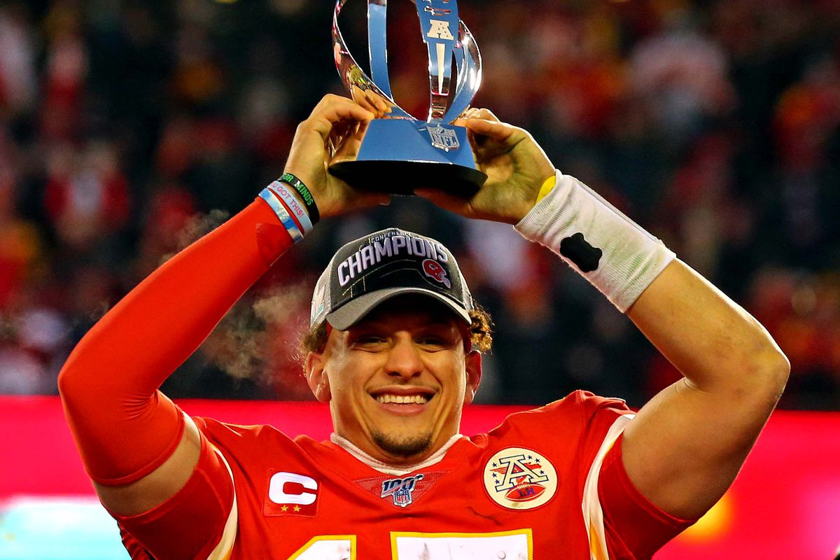 Kansas City Chiefs quarterback Patrick Mahomes celebrates with the Lamar Hunt Trophy after beating the Tennessee Titans in the AFC Championship Game at Arrowhead Stadium.