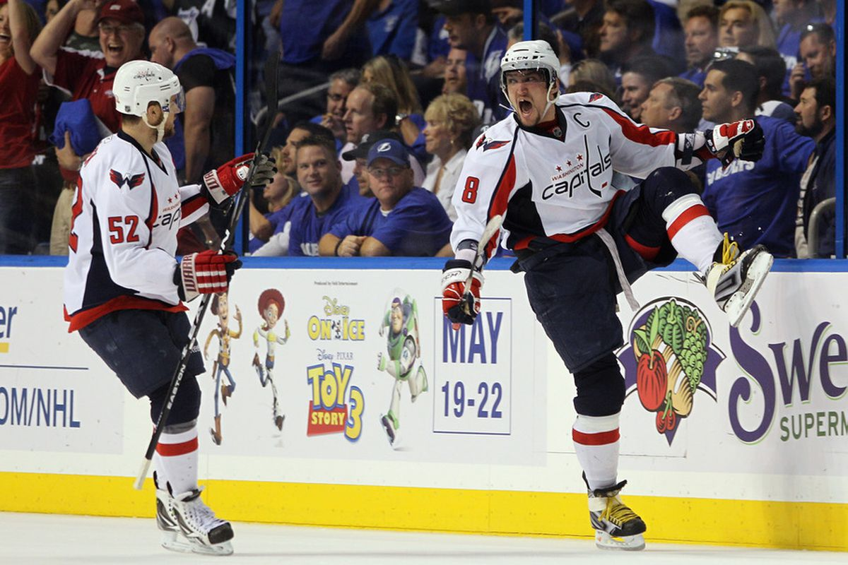 Alex Ovechkin of the Washington Capitals scores a power play goal against the Tampa Bay Lightning and is joined by Mike Green in Game Three of the Eastern Conference Semifinals.