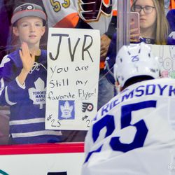 A young fan overlooks ones of his favorite players during warmups