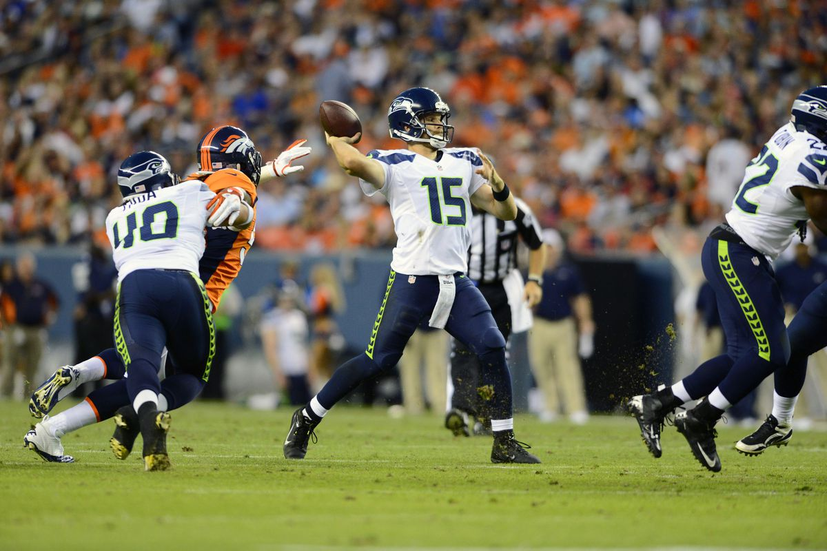 August 18 2012; Denver, CO, USA; Seattle Seahawks quarterback Matt Flynn (15) in the second quarter of a preseason game against the Denver Broncos at Sports Authority Field. Mandatory Credit: Ron Chenoy-US PRESSWIRE