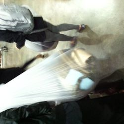 People with huge plastic bags.