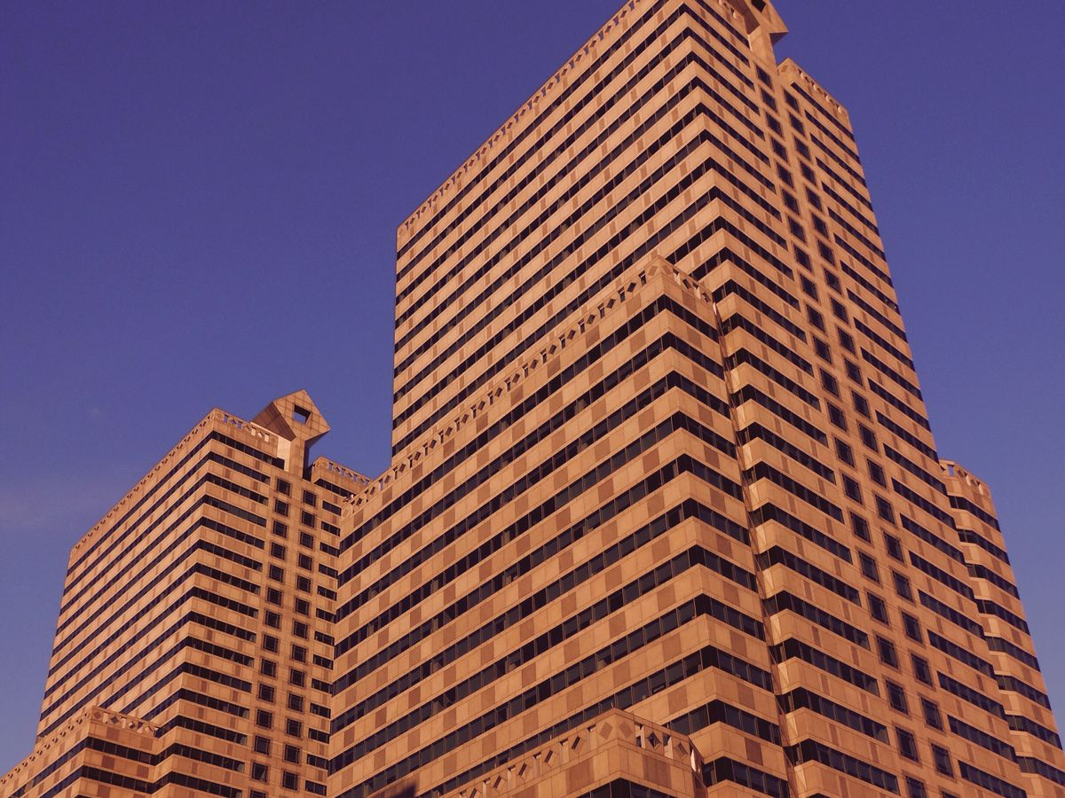 The exterior of One and Two Commerce Square in Philadelphia. The facades are brown brick.