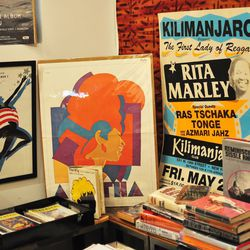 Collection of original print art of afro-centric pop culture by architect <b>John Reddick</b>.
