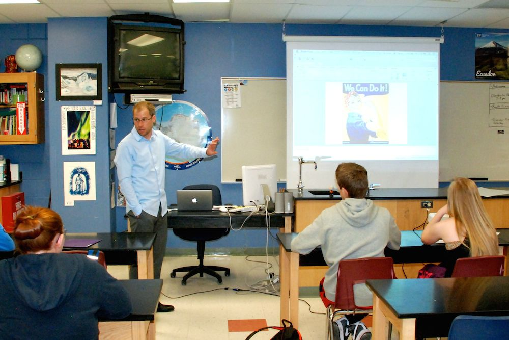 Highlands Ranch High School science teacher Bob MacArthur leads a class discussion May 16 on propaganda art. His ninth grade science class was asked to design a propaganda poster in support of an energy source they have been studying.