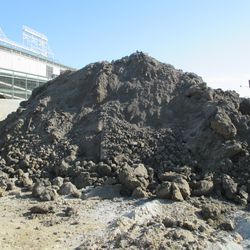 Excavation work on the Waveland side of the triangle lot -