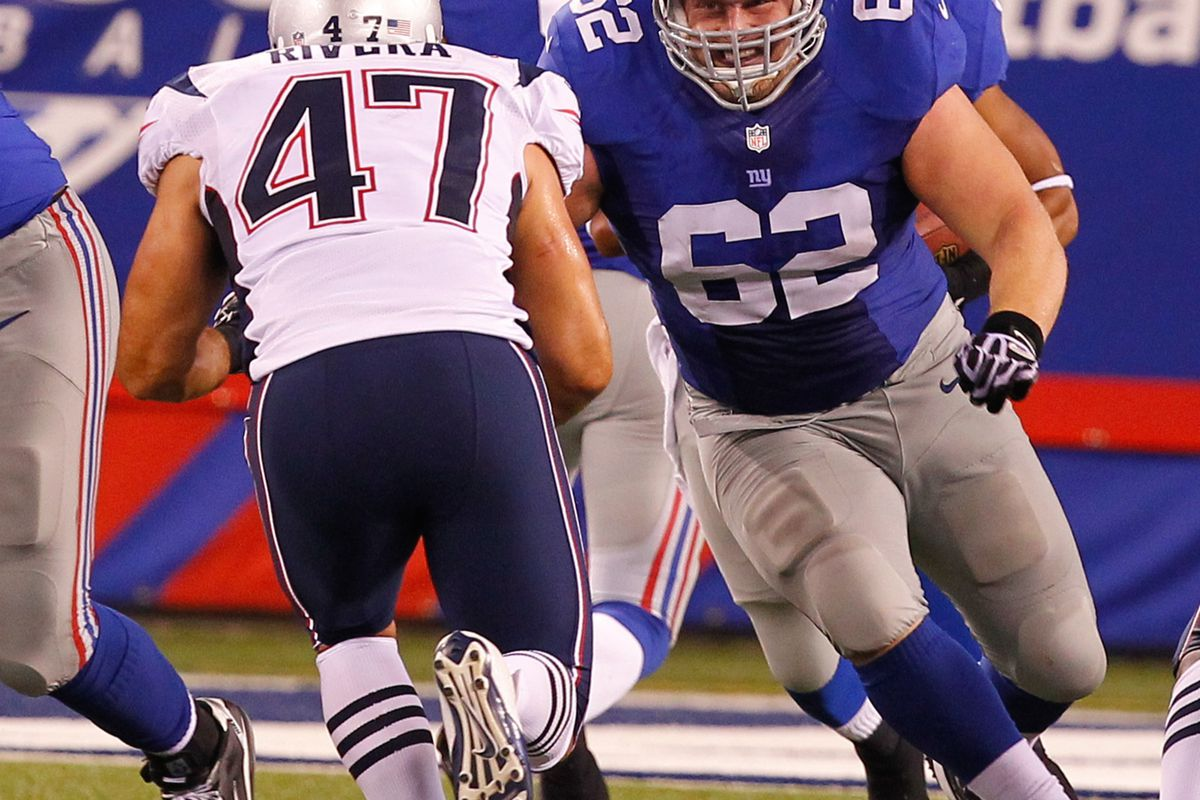 Aug 29, 2012; East Rutherford, NJ, USA;  New York Giants offensive guard Mitch Petrus (62) is set to block New England Patriots linebacker Mike Rivera (47) during the second half at MetLife Stadium. Jim O'Connor-US PRESSWIRE