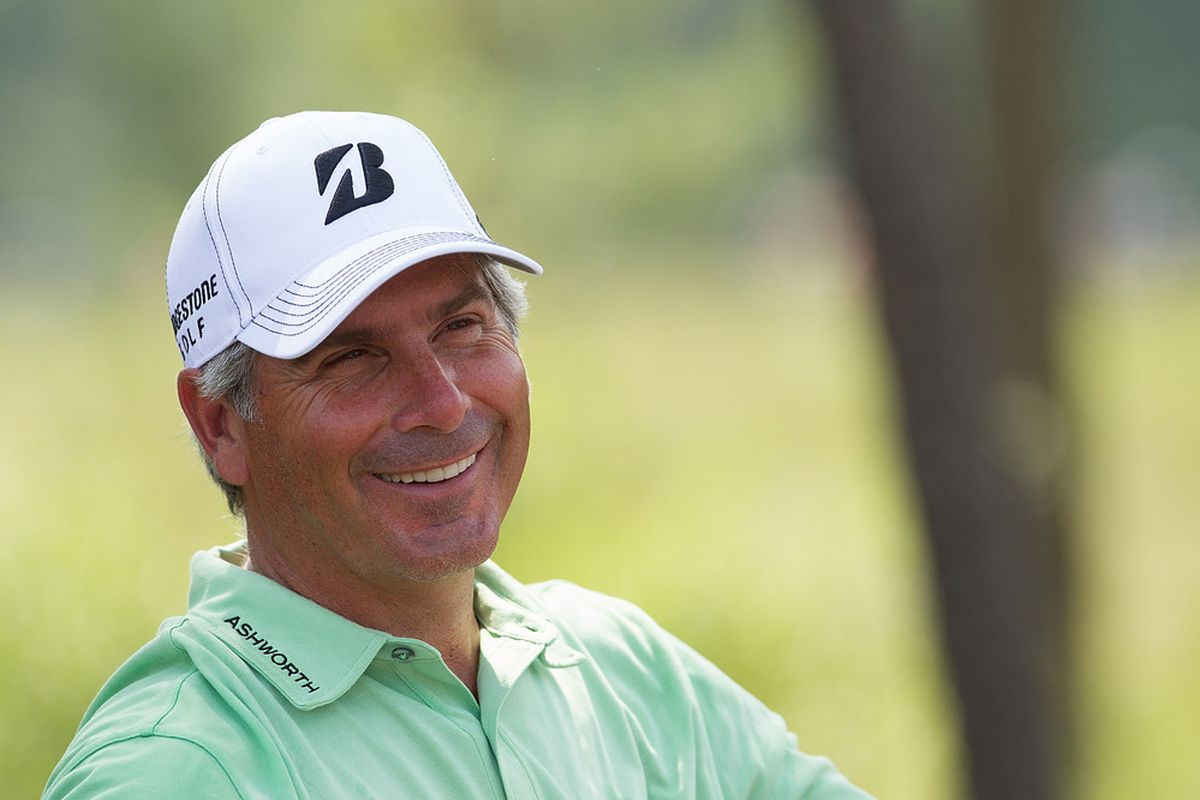 Mar 31, 2012; Humble, TX, USA; Fred Couples smiles as he waits his turn between the third and fourth holes during the third round of the Shell Houston Open at Redstone Golf Club-The Tournament Course.  Mandatory Credit: Allan Henry-US PRESSWIRE