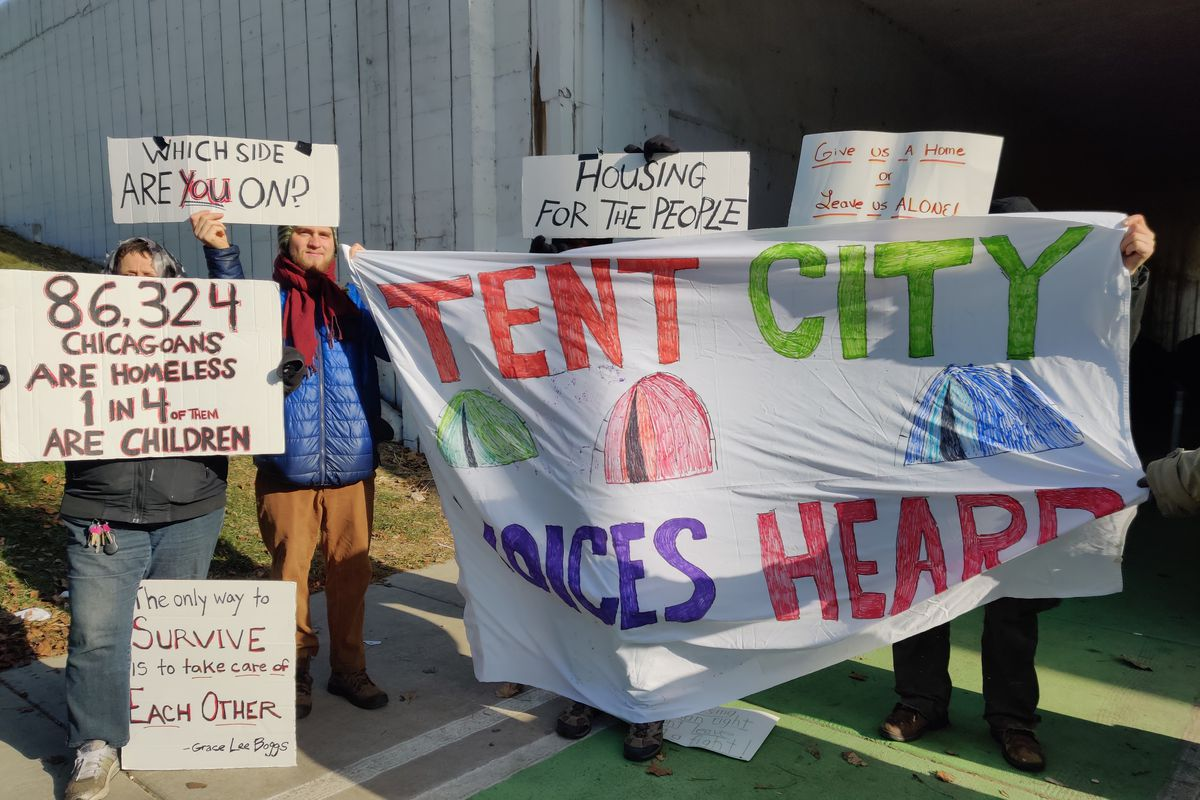 Residents of the Wilson Avenue viaduct at Lake Shore Drive and volunteers protest their potential eviction from their camp.