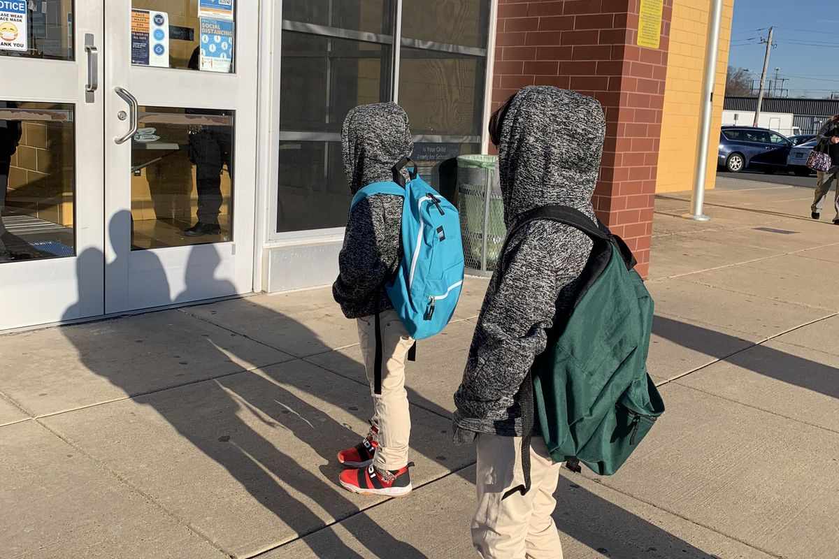 Students with backpacks outside school