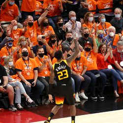 Fans cheer after Utah Jazz forward Royce O'Neale (23) hit a 3-point shot as the Utah Jazz and Memphis Grizzlies play Game 2 of their NBA playoffs first round series at Vivint Arena in Salt Lake City on Wednesday, May 26, 2021. Utah won 141-129.