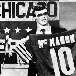 BYU quarterback Jim McMahon, the Chicago Bears' No. 1 draft choice, holds up his jersey at Halas Hall in Lake Forest on April 27, 1982.