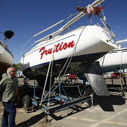 Utah DNR's Dan Clark looks over boats that are in dry dock after being pulled from the Great Salt Lake marina on Friday, Sept. 2, 2016. The marina was last dredged in 2008 and needs to be dredged another 5 feet.