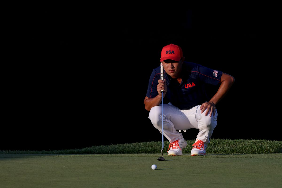 Collin Morikawa of Team United States lines up a putt on the 18th green, the fourth playoff hole for the bronze medal, during the final round of the Men's Individual Stroke Play on day nine of the Tokyo 2020 Olympic Games at Kasumigaseki Country Club on August 01, 2021 in Kawagoe, Saitama, Japan.