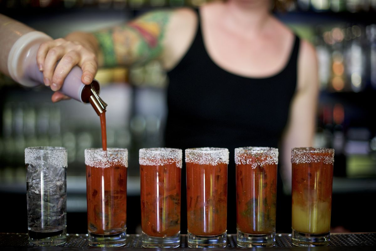 A picture of a bartender pouring bloody mary mix at Tasty n Alder