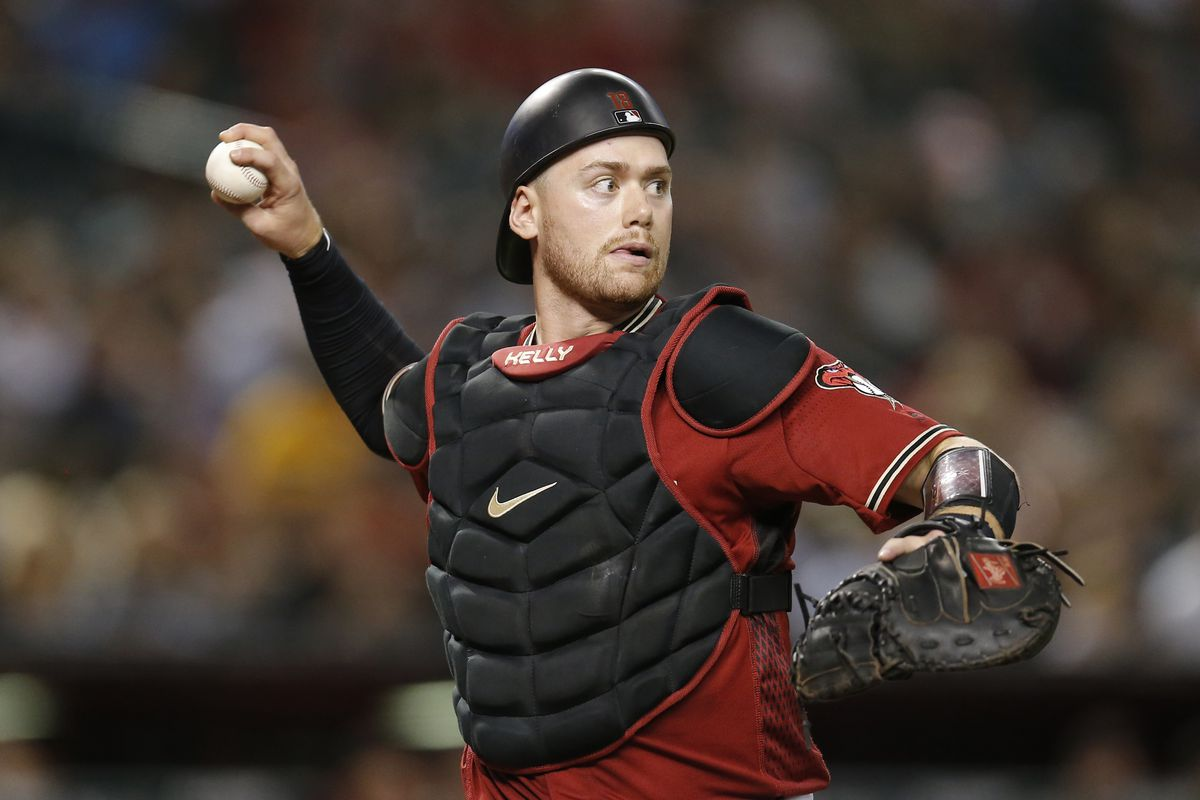 Arizona Diamondbacks catcher Carson Kelly (18) makes the throw for an out against the Philadelphia Phillies in the third inning at Chase Field.