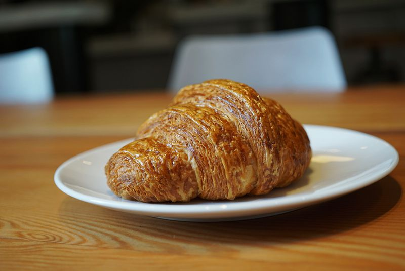 Fresh croissant on a plate at a restaurant.
