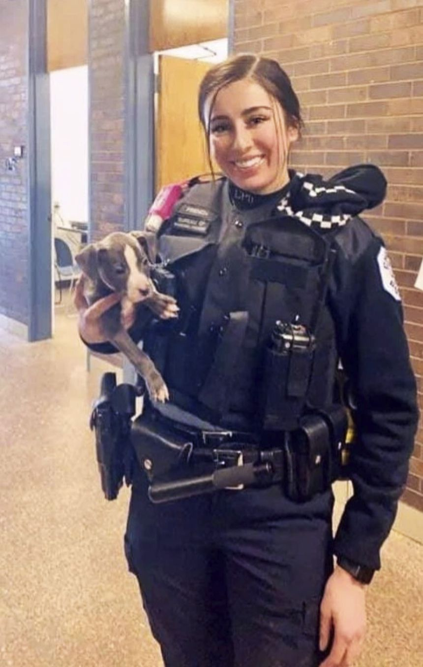 Officer Ella French with a dog she rescued as an unattended puppy and ended up keeping. Her mother Elizabeth French said this is her favorite photo of her daughter.