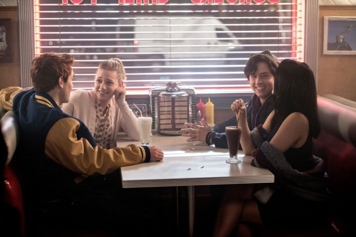K.J. Apa as Archie Andrews, Lili Reinhart as Betty Cooper, Cole Sprouse as Jughead Jones, and Camila Mendes as Veronica Lodge on Riverdale.