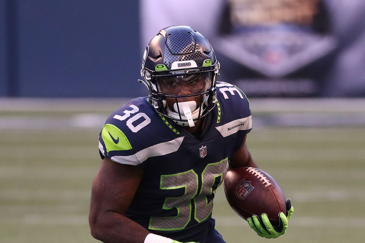 Carlos Hyde of the Seattle Seahawks runs with the ball in the second quarter against the New England Patriots at CenturyLink Field on September 20, 2020 in Seattle, Washington.