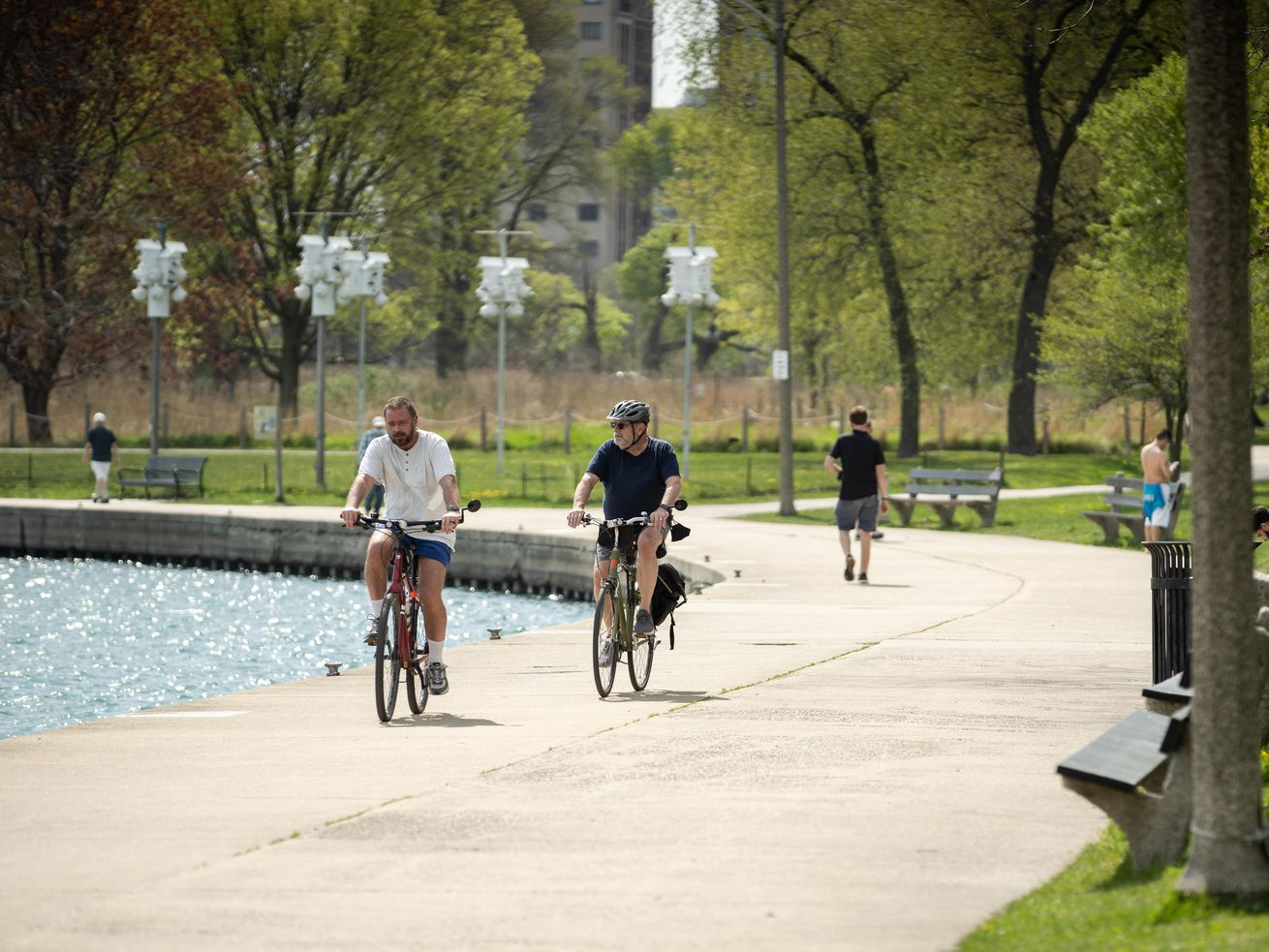 People bike around Montrose Harbor Tuesday, when temperatures topped 80 degrees. Saturday could be the city's hottest day of the year so far.