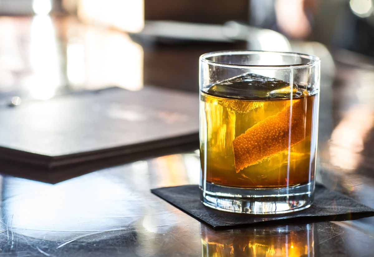 Whiskey cocktail with orange peel garnish
