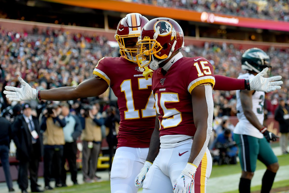 Washington WR Steven Sims celebrates with Terry McLaurin after scoring a touchdown against the Philadelphia Eagles during the first half at FedExField on December 15, 2019 in Landover, Maryland.