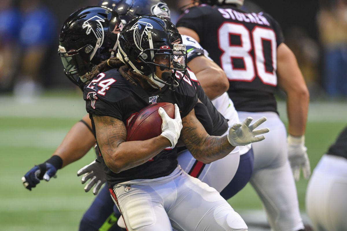 Atlanta Falcons running back Devonta Freeman runs the ball against the Seattle Seahawks during the second half at Mercedes-Benz Stadium.