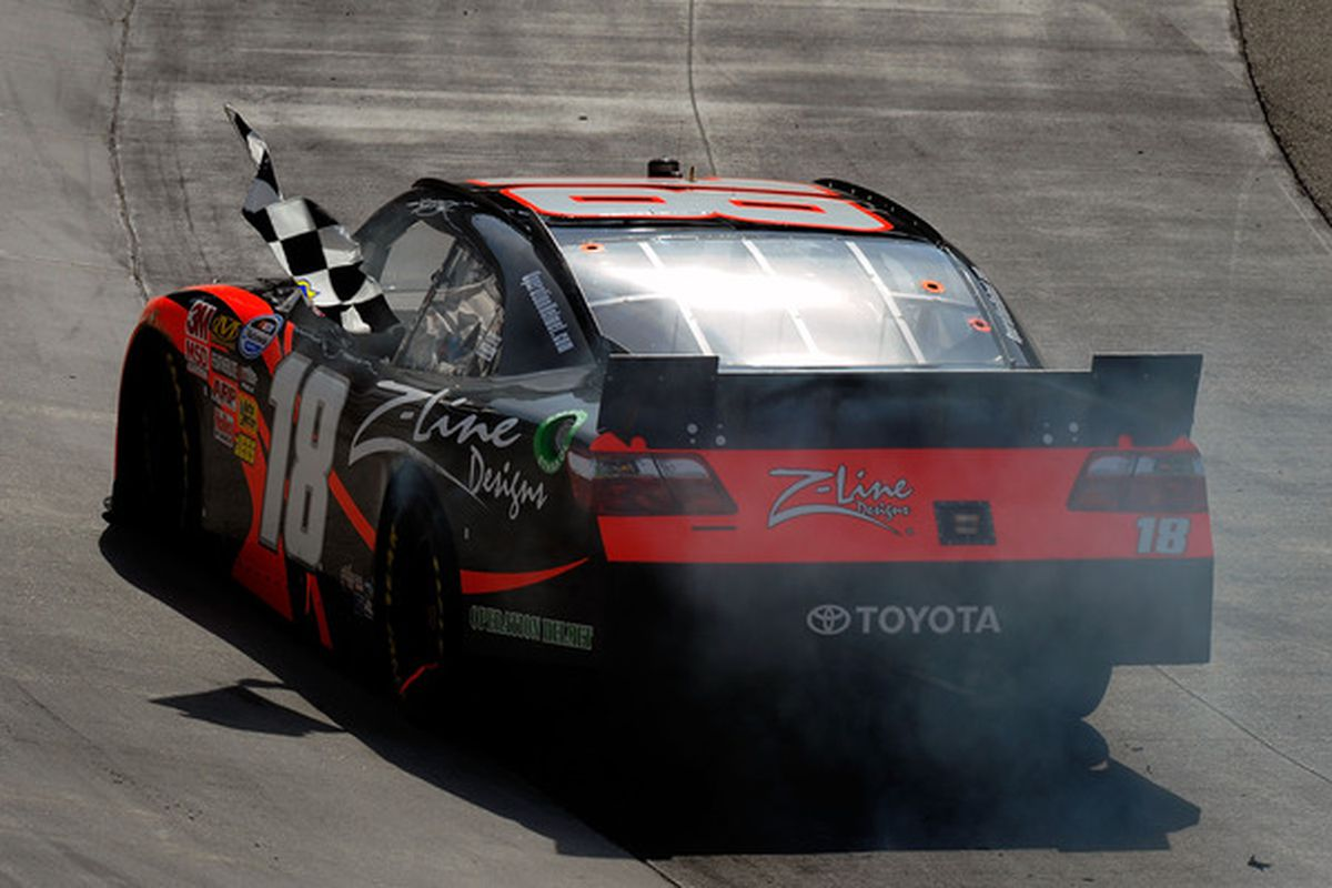 Kyle Busch celebrates after taking the checker flag for the NASCAR Nationwide Series Scotts EZ Seed 300 at Bristol Motor Speedway.