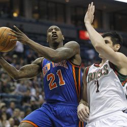 New York Knicks' Iman Shumpert (21) drives against Milwaukee Bucks' Ersan Ilyasova (7) during the first half of an NBA basketball game on Wednesday, April 11, 2012, in Milwaukee.