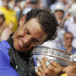 Spain's Rafael Nadal holds the cup after defeating Switzerland's Stan Wawrinka in their final match of the French Open tennis tournament at the Roland Garros stadium, Sunday, June 11, 2017 in Paris. Nadal has won his record 10th French Open title, beating No. 3 Stan Wawrinka in straight sets
