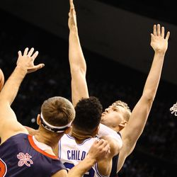 Brigham Young Cougars forward Yoeli Childs (23) hooks a ball over the defense of Saint Mary's center Jock Landale (34), guard Tanner Krebs (00) and forward Calvin Hermanson (24) as the BYU Cougars take on the Saint Mary's Gaels in the Marriott Center in Provo on Saturday, Dec. 30, 2017.