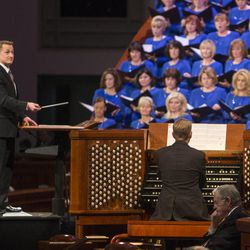 Tabernacle choir Assistant conductor, Ryan Murphy leads the choir during the Saturday morning session of the 183rd Semiannual General Conference for the Church of Jesus Christ of Latter-day Saints Saturday, Oct. 5, 2013 inside the Conference Center.