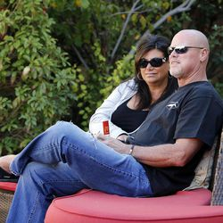 Jim McMahon is interviewed in Layton on Oct. 1. At left is his girlfriend, Laurie Navon.