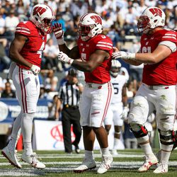 Wisconsin Badgers wide receiver A.J. Taylor (4) celebrates after scoring on the Brigham Young Cougars, putting the Badgers up 31-6 after that PAT, during the game at LaVell Edwards Stadium in Provo on Saturday, Sept. 16, 2017.