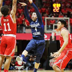 Brigham Young Cougars guard Nick Emery (4) passes out of trouble as Utah and BYU play in the Huntsman Center in Salt Lake City Wednesday, Dec. 2, 2015.