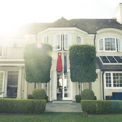 """Monique Lhuillier's dresses decorate the exterior of her home. Photo via <a href=""""http://www.thecoveteur.com/monique_lhuillier"""">The Coveteur</a>."""